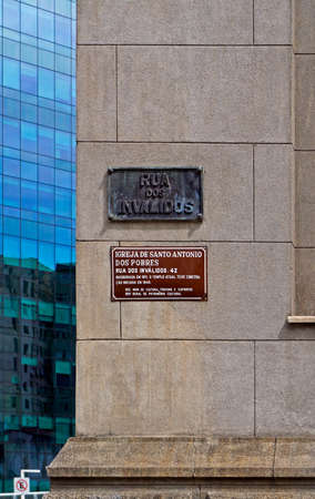 Rio de Janeiro, Brazil - April 26, 2017: Street plaque of bronze on the wall and indicative plate of Saint Anthony church in downtown Rio.
