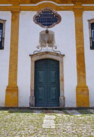 Ancient baroque church door in Ouro Preto, Brazil Foto de archivo