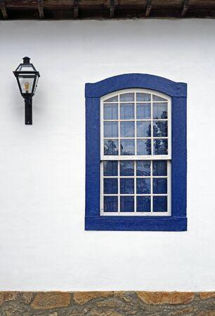 Colonial window and lantern in Ritapolis, Minas Gerais, Brazil