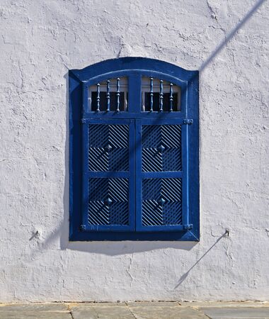 Colonial window at historical city of Diamantina, Brazil