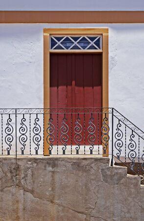 Handrail grid and old door in Serro, Minas Gerais, Brazil