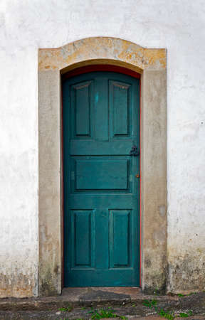 Ancient colonial door at historical city of Ouro Preto, Brazil