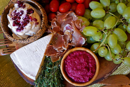 Cheese, Parma ham, sauce and fruits on the table Archivio Fotografico