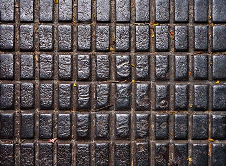 Rusty metalllic surface, manhole cover detail Archivio Fotografico