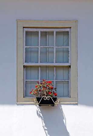 Window with flower pot in historical city of Diamantina, Brazil Imagens