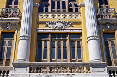 Ancient yellow facade dating from 1913, downtown Rio, Brazil
