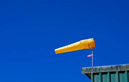 Yellow windsock and blue sky