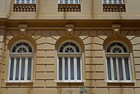 Windows on yellow facade, Belo Horizonte, Brazil