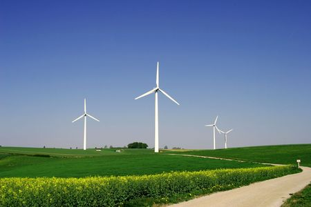 clime: 4 modern wind energy plants Stock Photo