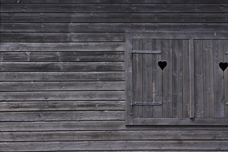pranks: dark colored wooden window framed by wooden pranks  Stock Photo