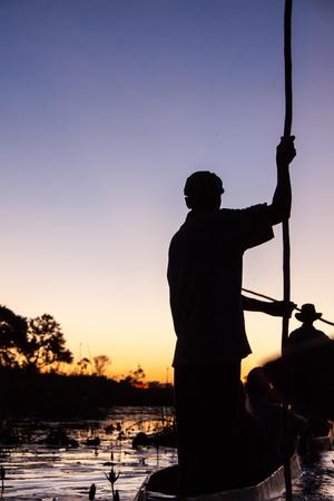 okavango delta: Mokoro Poler in Okavango Delta
