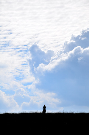 breaking new ground: A man looking on the sky Stock Photo