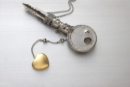 Golden heart chain necklace  with key  photo