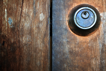 Old wooden door with keyhole photo