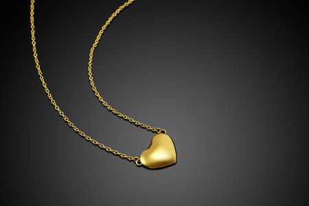 Golden heart with necklace chain photo