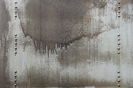 Dirty oil stains on metal surface of riveted metal from aircraft photo
