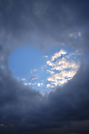 stormy: Heart shaped cloud on stormy sky.