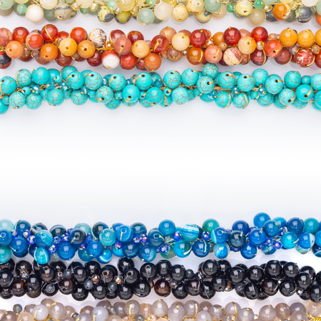 Colorful of Chakra bracelets made from natural stone the design for women fashion on isolated white background - Lots of people wear its because they believe the power of healing for good healthy Stock Photo