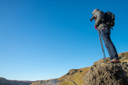 A traveler enjoy the view of Gullfoss waterfall , Iceland