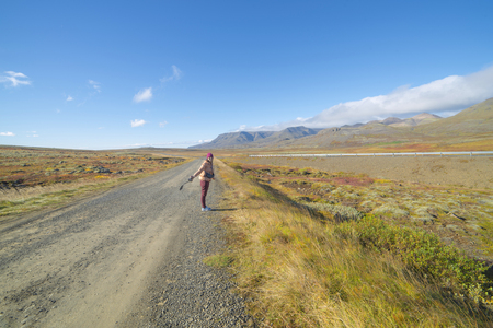 An asian woman tourist scenic on the road in iceland