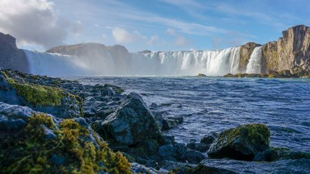 The Godafoss huge waterfalls and blue sky. One of most famous place in Iceland Banco de Imagens