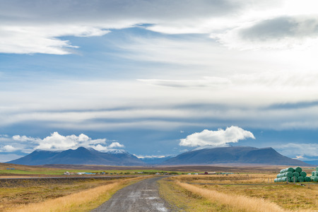 The road to volcanic mountain. Beautiful perspective view rural scene landscape in  west Iceland.