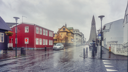 Beautiful Perspective street view from downtown to Hallgrimskirkja the modern cathedral this photo taken between rain storm, Reykjavik the capital of Iceland Stock Photo