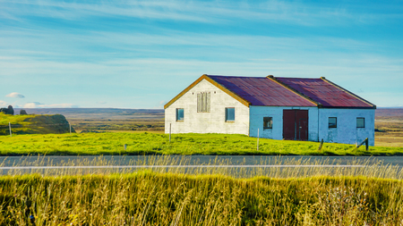 Beautiful rural view traditional house and farm field at small village in Svalbardseyri near Akureyri, Iceland 版權商用圖片