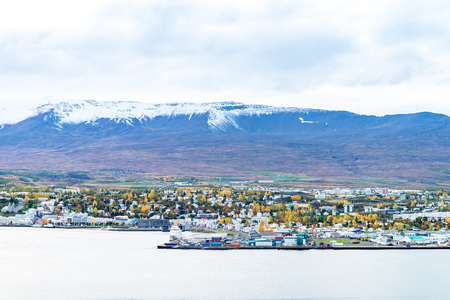 Beautiful scenery of Akureyri city from tourist viewpoint across the sea and Eyjafjordur fjord in iceland
