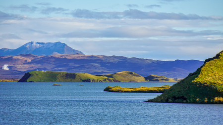 Myvatn lake in Northern Iceland. Islet of volcanic pseudo crater is a middle. Landscape of Myvatn lake in Northern Iceland