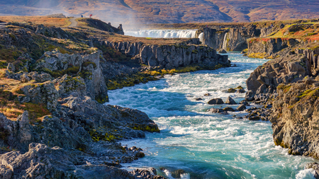 What a beautiful day at Godafoss waterfall. The water from cascade powerful streaming to the ocean. Godafoss, Iceland