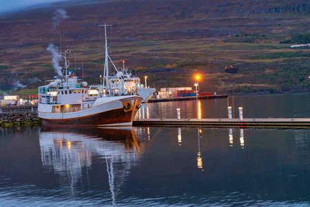 Fishing boat docking in port Akureyri city in Iceland