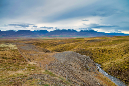 The volcanic mountain range and hill. Beautiful perspective view rural scene landscape.The photo taken from near reykjavik city south of Iceland.