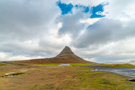 Beautiful landscape of Kirkjufellsfoss waterfall and mountain and cloudy sky. Iceland Reklamní fotografie