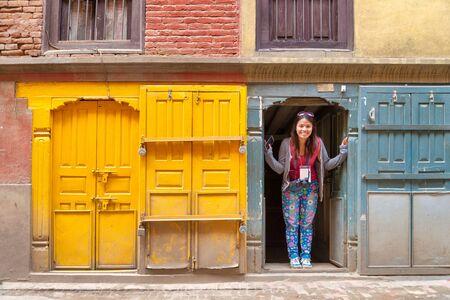 A women tourist enjoying with beautiful vintage window and door background at Kathmandu, Nepal