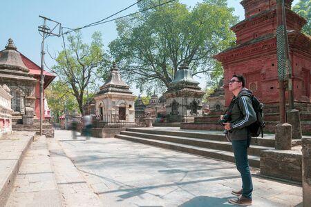 An asian man tourist enjoy viewing historic building at Gorakhnath Temple, Nepal