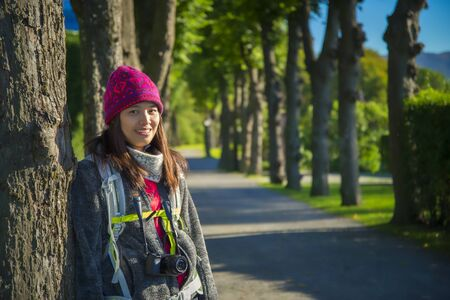 Beautiful asian woman tourist portrait and perspective view in the garden at Bergenhus Fortress, Bergen, Norway
