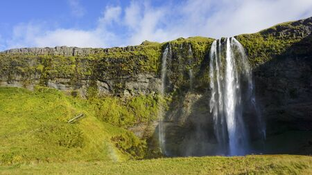 Beautiful Seljalandsfoss one of famous waterfall in Iceland and sunny day and blue sky in summer. Stok Fotoğraf