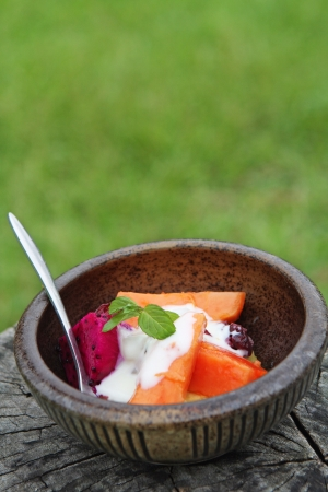 Refreshing exotic fruit salad with papaya and dragon fruits