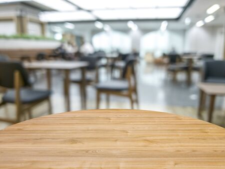 wood table on blur of coffee shop , can used for display or montage your products 写真素材