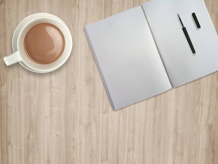top view table desk. Workspace with blank notebook,pen and coffee cup on wood background 스톡 콘텐츠 - 132046839