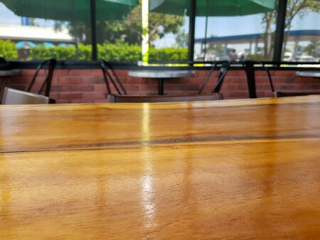 blurred background with wood table at coffee cafe