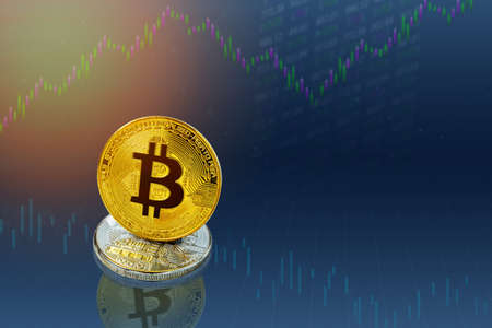 Bitcoins and New Virtual money concept. Gold bitcoins with Candle stick graph chart and digital background. Golden coin with icon letter B or blockchain technology