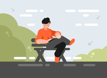 Young illustrator sitting on a park bench and drawing on a tablet
