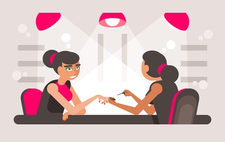 Painting female fingernails. Women getting her nails painted in the beauty salon