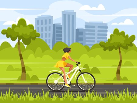 Woman on bicycle in the park