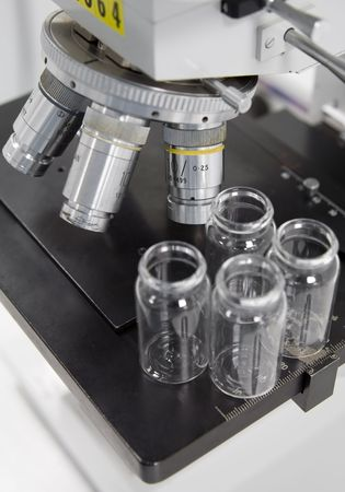 eyepiece: Microscope and small bottles Stock Photo