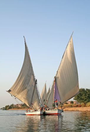 nile: Two feluccas sailing together on Nile River, Egypt Stock Photo