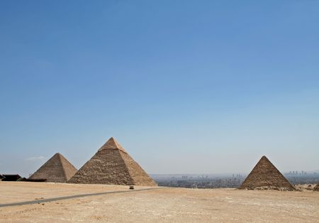 pyramid peak: Pyramids with hazy city view at the background Stock Photo