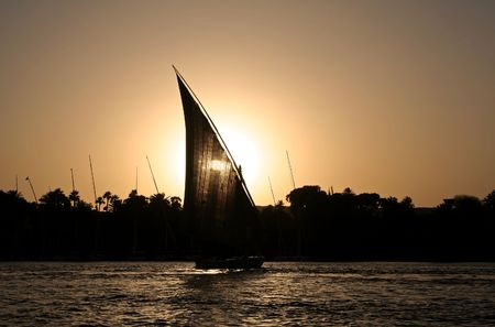 nile: A felucca sailing at the Nile River during sunset time